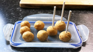 Balls of dough with sticks in