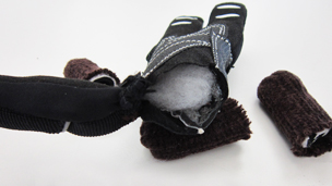 A black glove with stuffing inside