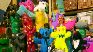 A selection of different glove toys that are really brightly coloured