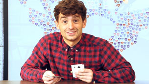 Fergus Flanagan holding a playing card