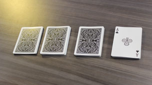 Four packets of cards with an ace revealed on top of the final packet