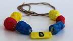 A colourful papier mache bracelet