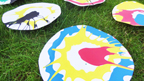 A photo of a selection of finished spin art pictures with lots of different colours