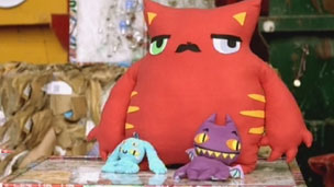 Assortment of Monster cuddly toys and cushions
