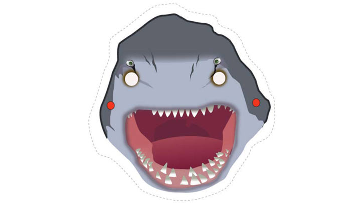 Cut-out mask of a Shark with its jaws wide open.