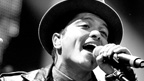 Black and White photo of Bruno Mars singing on stage