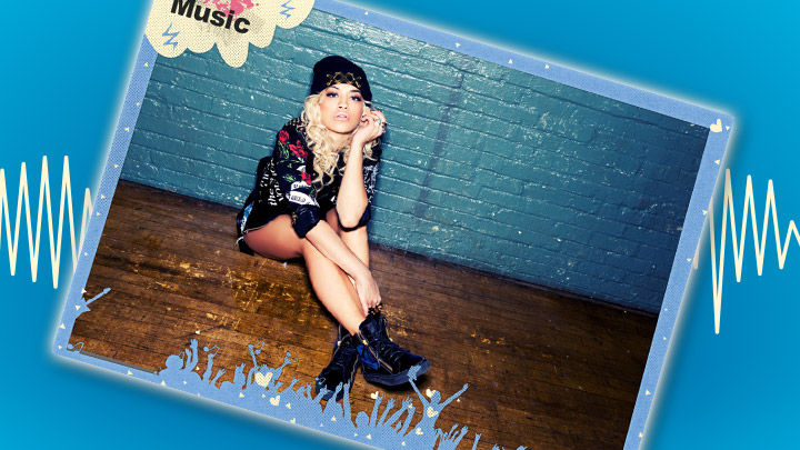 Rita Ora poster on a blue background with a soundwave behind it.