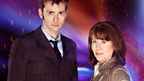 The Tenth Doctor and Sarah Jane standing side by side staring forward.