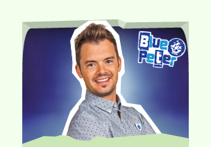 Blue Peter presenter Barney Harwood holding a camera