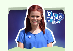 Lindsey with her blue peter badge