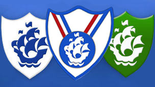 Different coloured Blue Peter badges lined up in a row