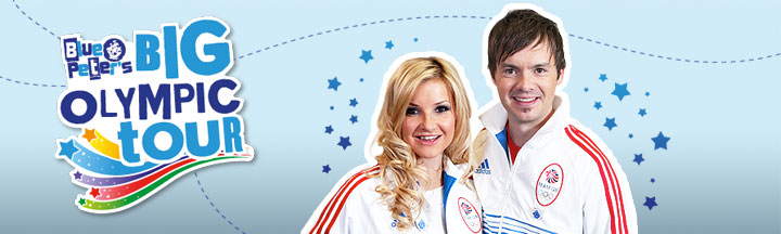Blue Peter presenters Helen Skelton and Barney Harwood in white track suits.