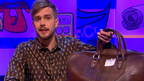 Iain Stirling with a schoolbag.