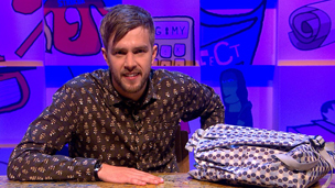 Iain Stirling with a celebrity schoolbag.