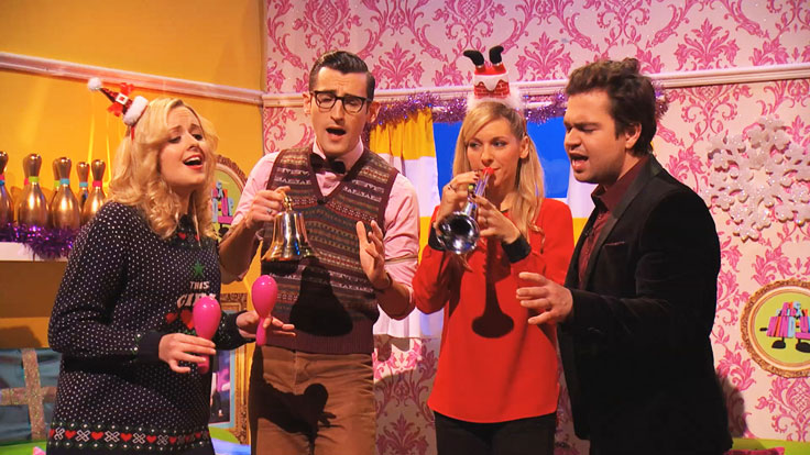 CBBC stars are singing passionately dressed in Christmas outfits