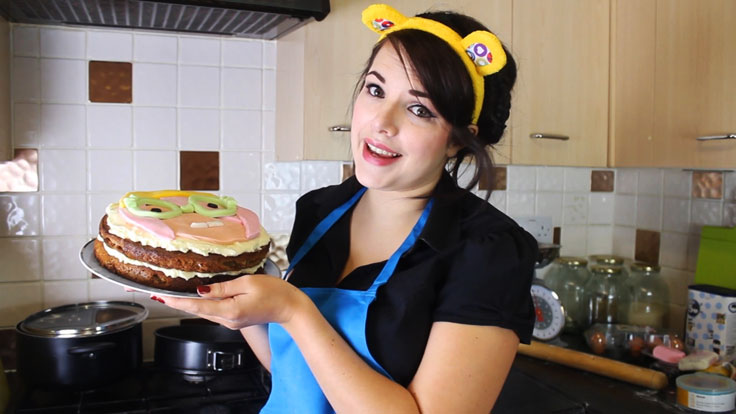 Cherry Wallis wearing Pudsey ears, with her Becky Mitchell carrot cake.