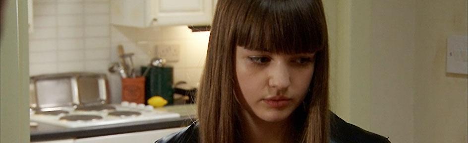 Lauren looking upset with her dad.