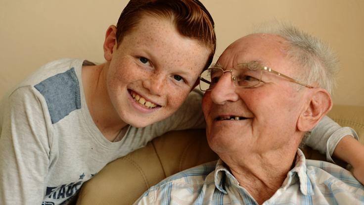 A boy and his grandad hugging