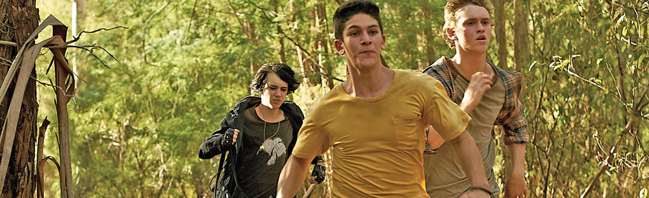 Jake, Sam and Felix race through the woods, panicked.