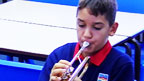 Ben attempts to play the trumpet for the first time