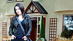 Tracy Beaker stood in front of the Dumping Ground.