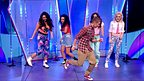Aidan Davis and Little Mix dancing on stage.