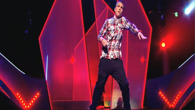 Aidan Davis dancing on stage.