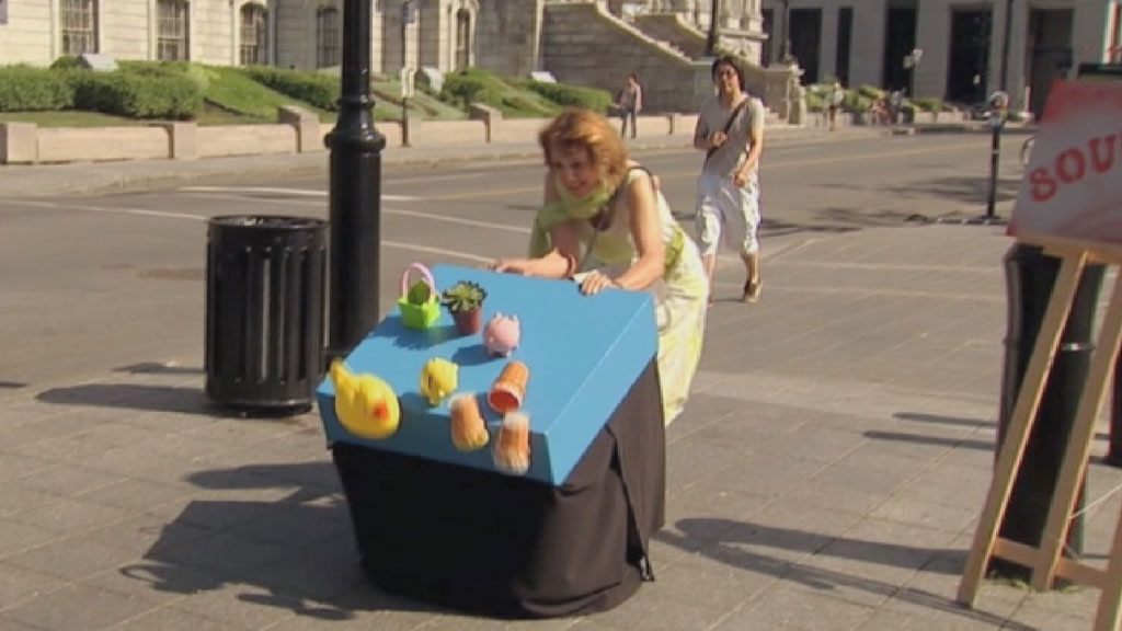 Woman trying to prevent table from falling over.