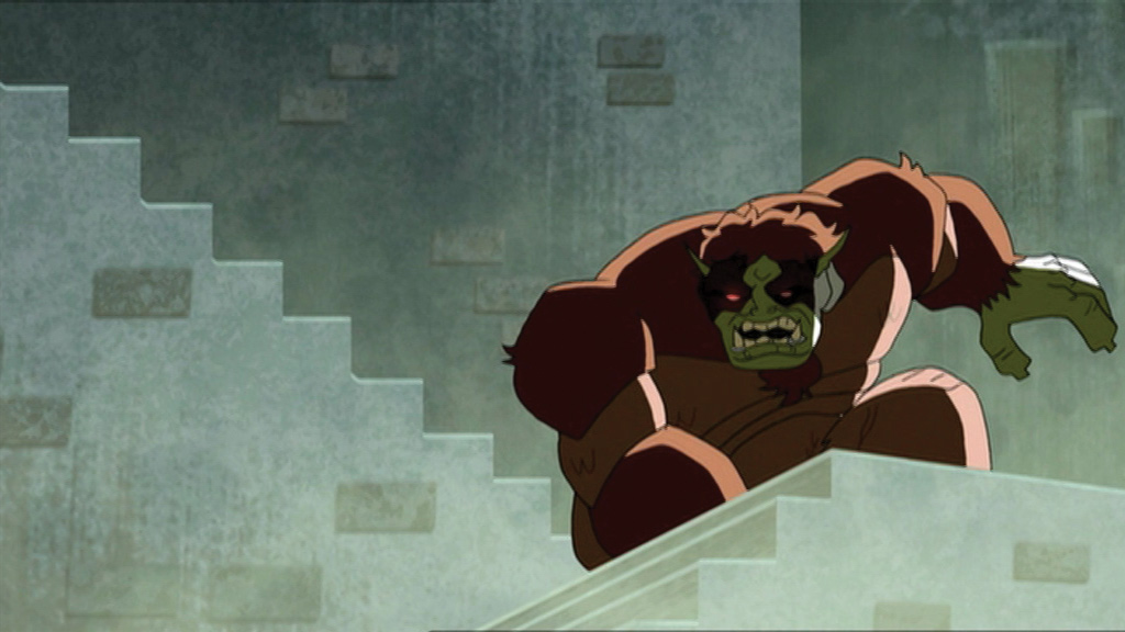 A large Gorilla-like monster in front of an old stone building