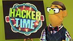 Derek looks to camera infront of the Hacker Time logo