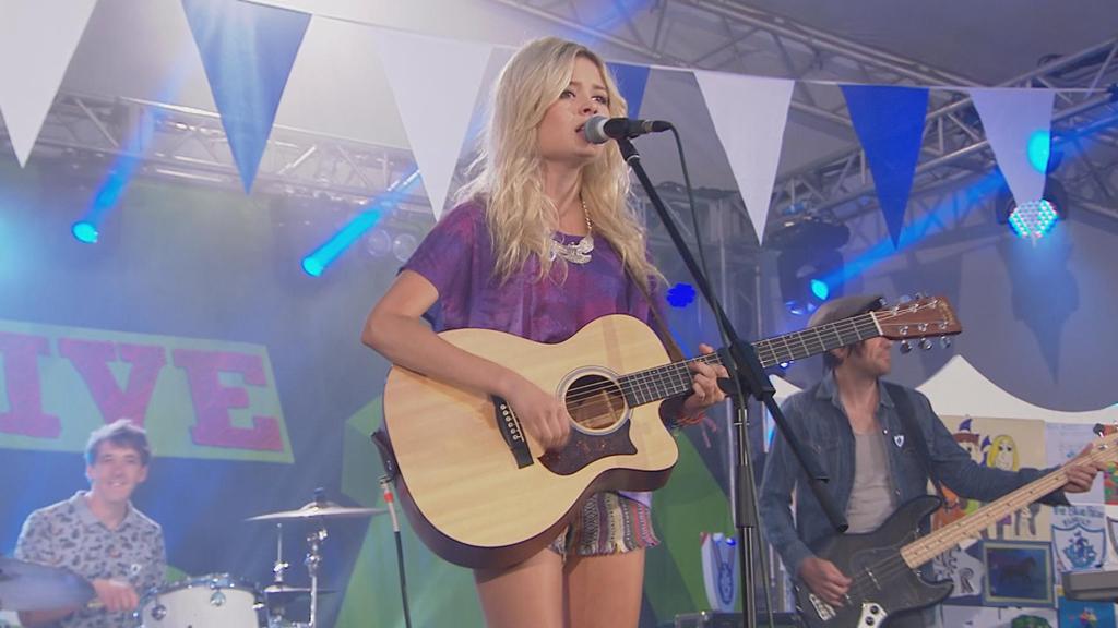 Nina Nesbitt on stage singing