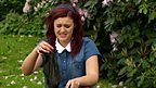Ashleigh from Ashleigh and Pudsey in 'Britain's Got Talent' holding some rubbish!