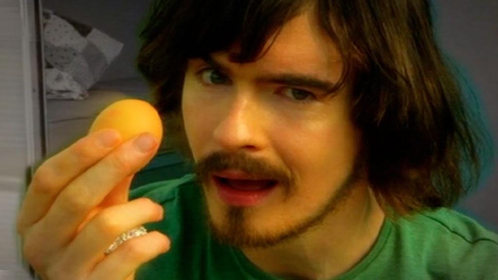 Max Byrne holding an egg.