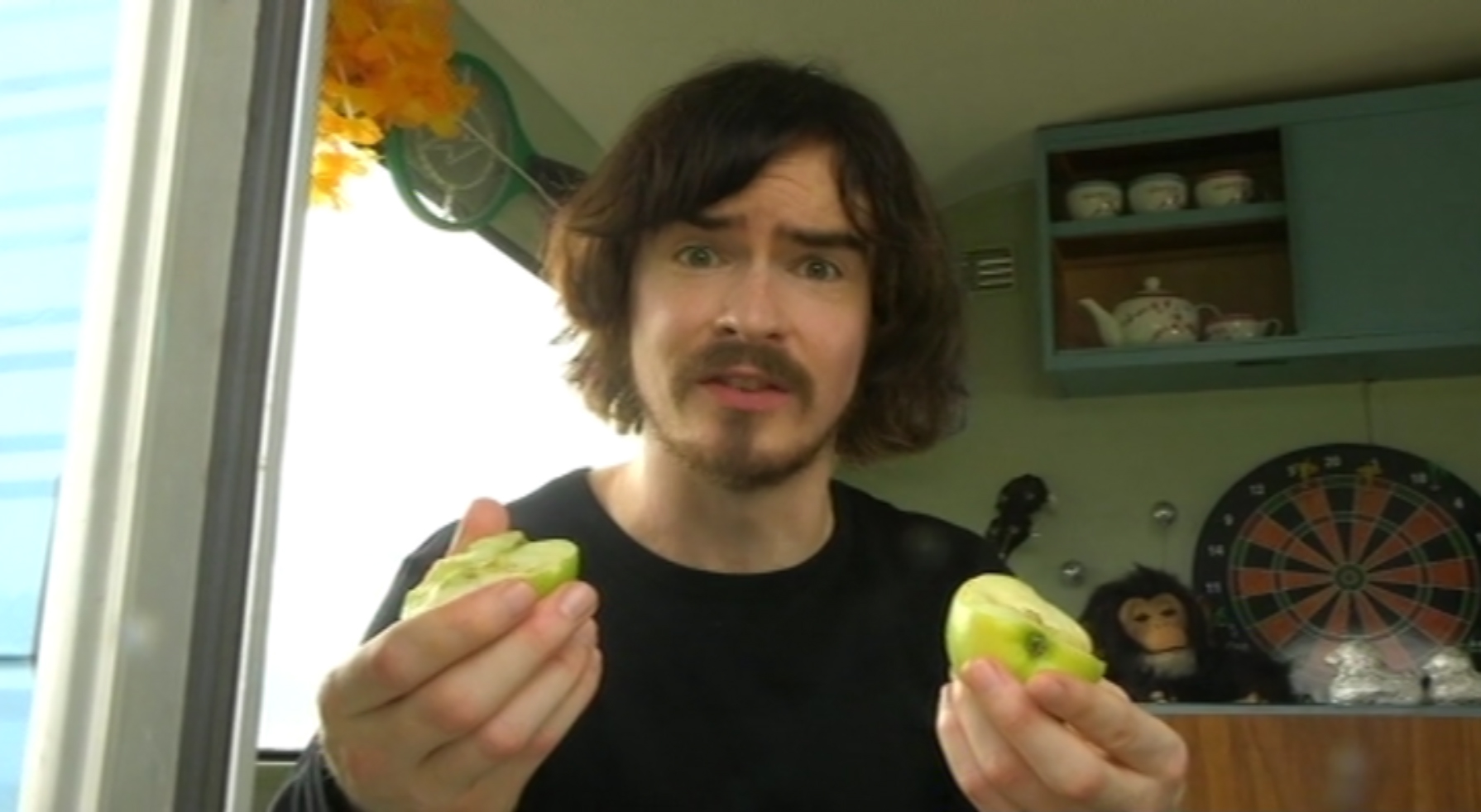 Max Burn holding an apple.