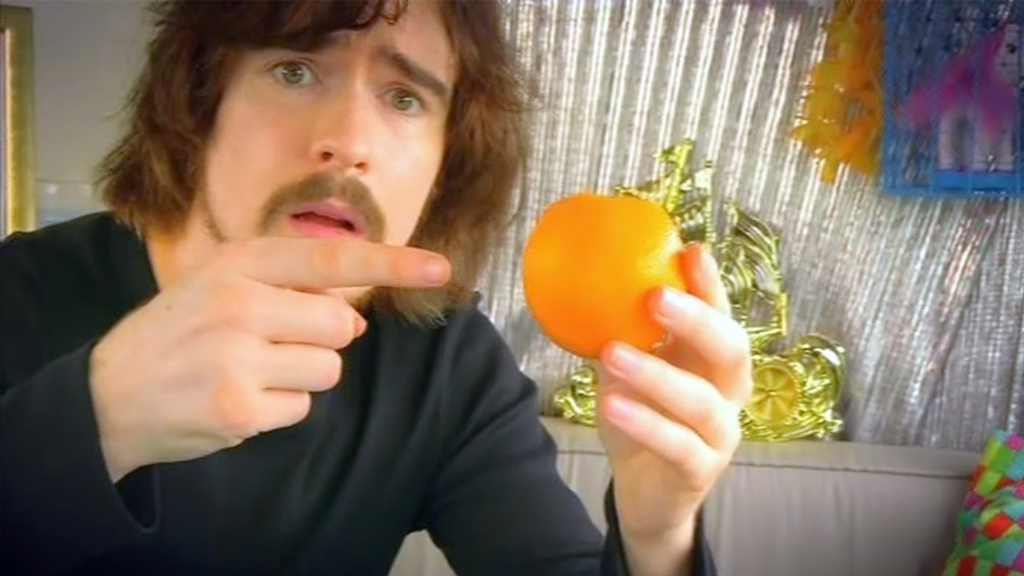 Max Byrne holding an orange.