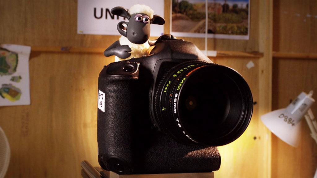 A Shaun the Sheep model behind a camera.
