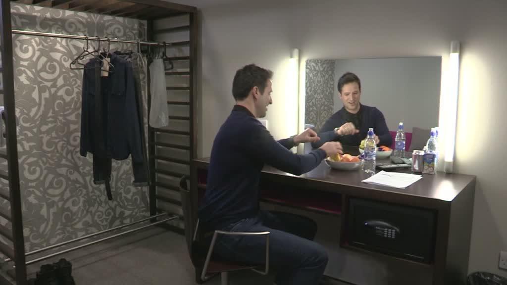 John in his dressing room.