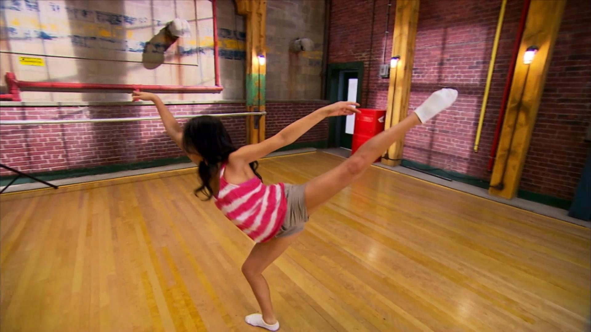 A dancer doing a ballet dance move.