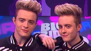 Sam and Mark are in a living room with Jedward and a gorilla