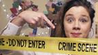 Shari pointing at crime scene tape
