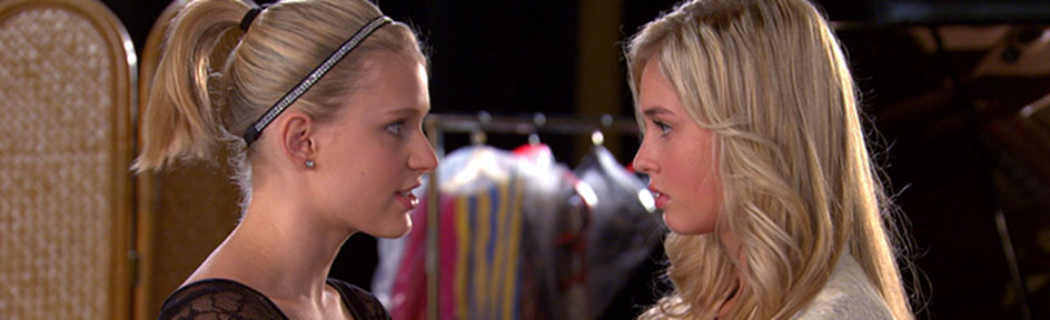 Emily and Michelle talking to each other at Elite.