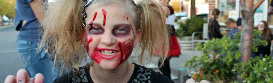 A girl dressed up as a zombie.