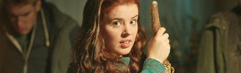 Jana, from Wolfblood, holds a crook.