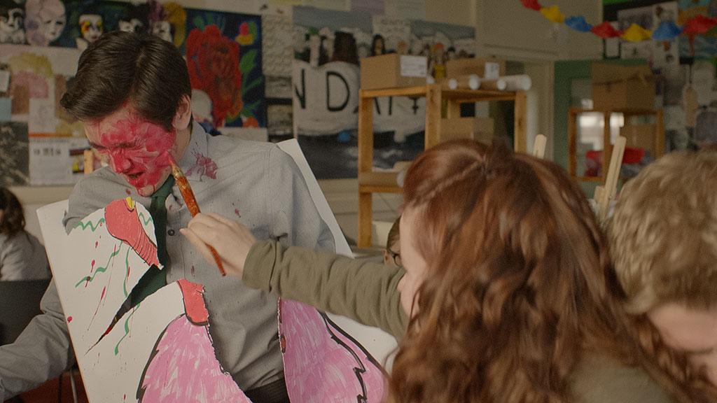 Jana painting Jimi's face.