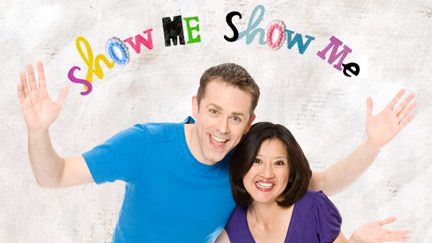 Chris and Pui with the Show Me Show Me logo