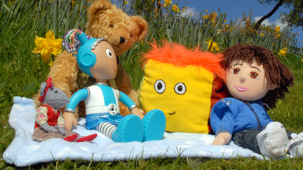 The Show Me Show Me toys sat on a picnic blanket