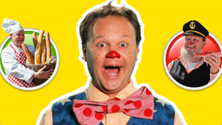Mr Tumble holding a bunny rabbit.