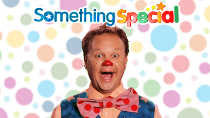 Mr Tumble on a spotted background.