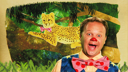 Mr Tumble and a cheetha in the jungle.