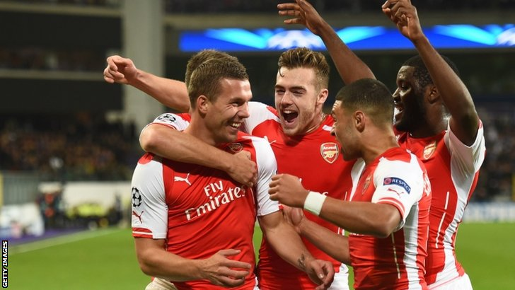 Lukas Podolski celebrates with teammates